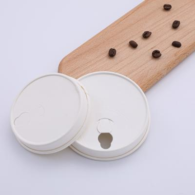 White paper coffee cup lids